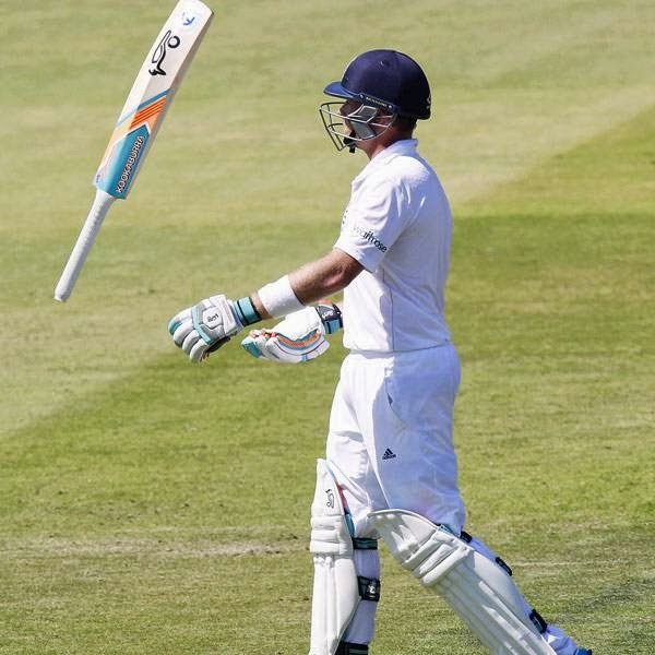 England's Ian Bell tosses his bat as he walks back to the pavilion after his dismissal for 16 runs during the second day of the second Test cricket match between England and India, at Lord's Cricket Ground in London, England on July 18, 2014.