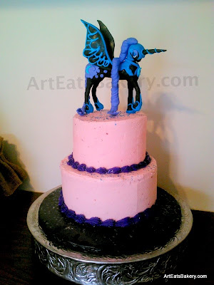 Two tier pink and purple buttercream girl's birthday cake with My Little Pony Nightmare Moon sugar figure cake topper