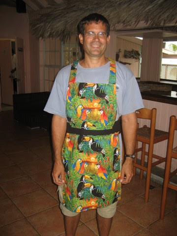 Derek modeling the Tropical Bar Apron for LaTisha