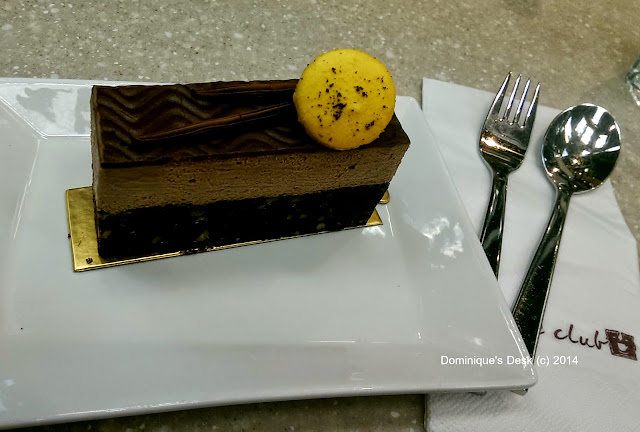 Chocolate cake with a yellow macaroon