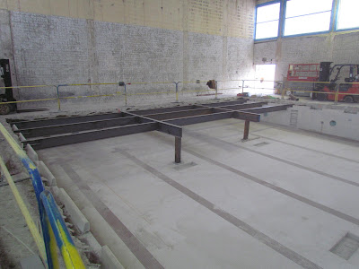 Steel erection for middle school gym floor