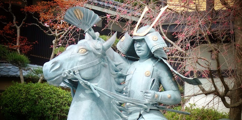 A statue of a Samurai riding a horse