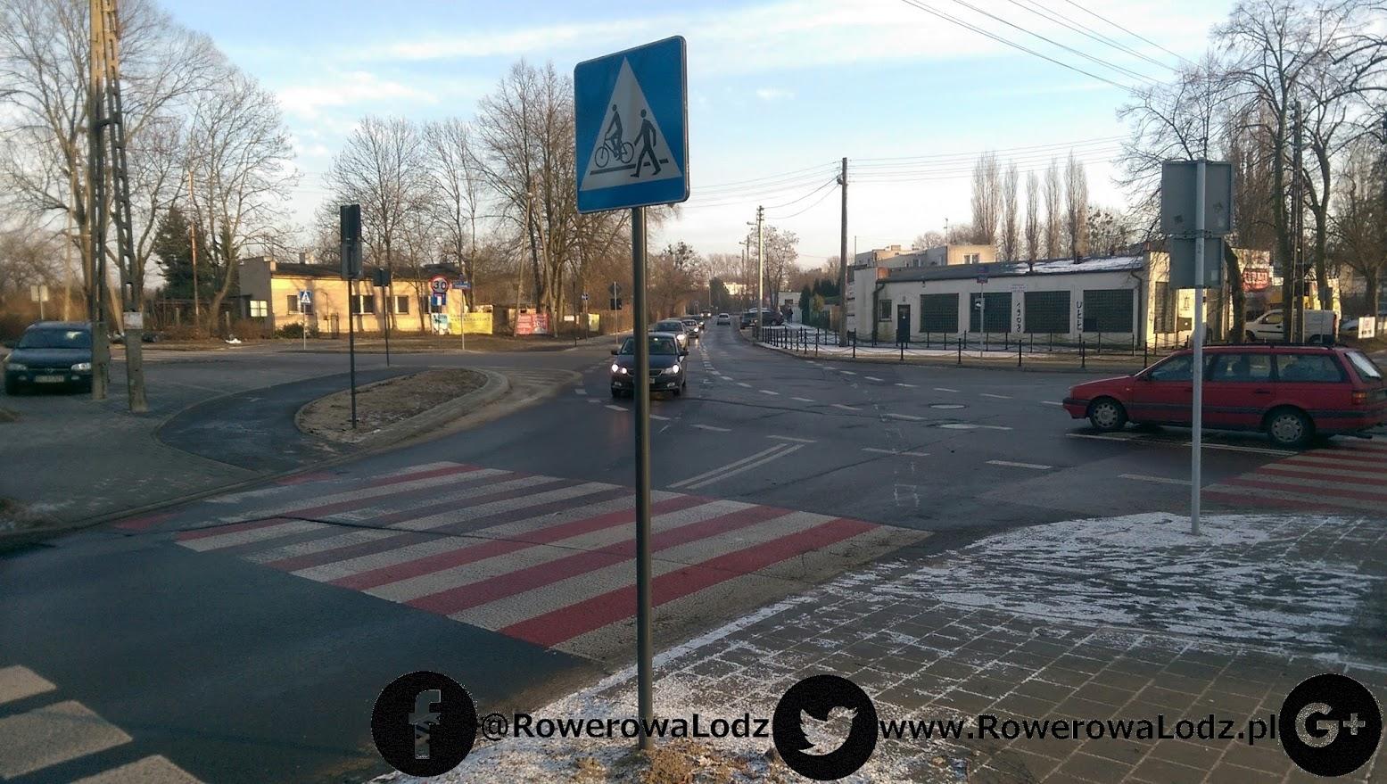 Skrzyżowanie z ul. Borową. Znaki pionowe mówią o przejeździe, którego jeszcze nie wymalowano.