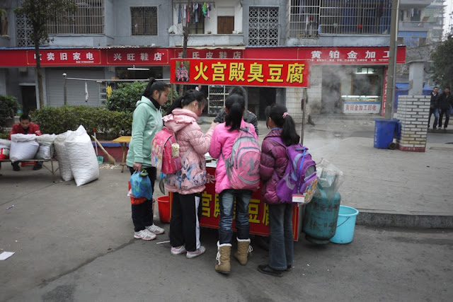 students at a stinky tofu street stand in Hengyang, Hunan province, China