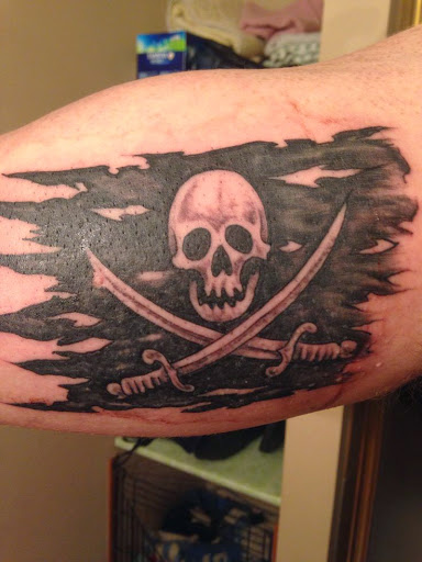 Skull Tattoo With Flying Birds And Written Quotes On Thigh Which Is Looking Awesome