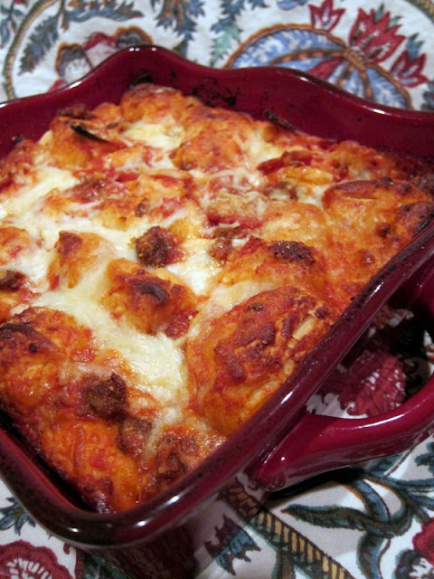 Bubble Up Pizza - only 4 ingredients and ready in under 30 minutes! Refrigerated biscuits tossed in pizza sauce,topped with mozzarella and your favorite pizza toppings. We LOVE this casserole! We make this at least twice a month!!