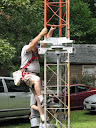 Terry W8ZN climbs microwave tower