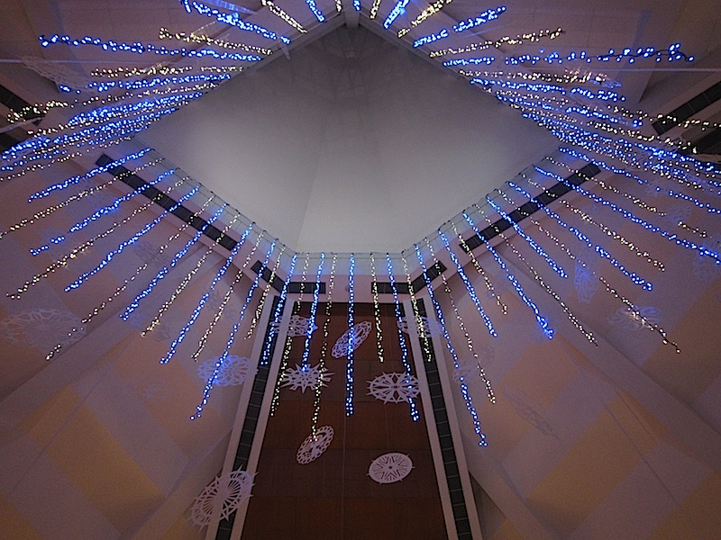 Christmas lights and decorations hanging from the cupola of the Ateneo Church of the Gesù