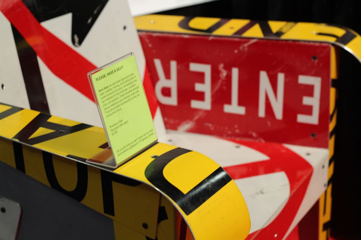 a chair made of traffic signs