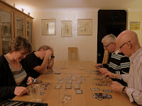 The players counting their victory points at the end of a game of Dominion