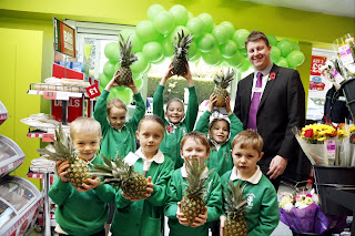 Copyright Dave Moss Photography Ltd www.davemoss.co.uk 07977516933 Offical opening of the Co-Op store in Broughton North Lincolnshire by pupils of Broughton Infants School.   Pineapple Pupils Freya Savage, Eve Foster, Eleanor Credland, Elliott Taylor, and Jack Houldsworth check out the fruit and veg in the store