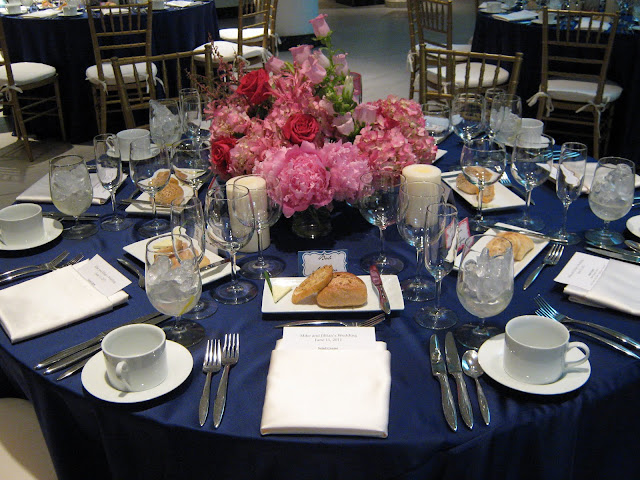 Pink Centerpiece on navy blue cloth with gold chivari chairs