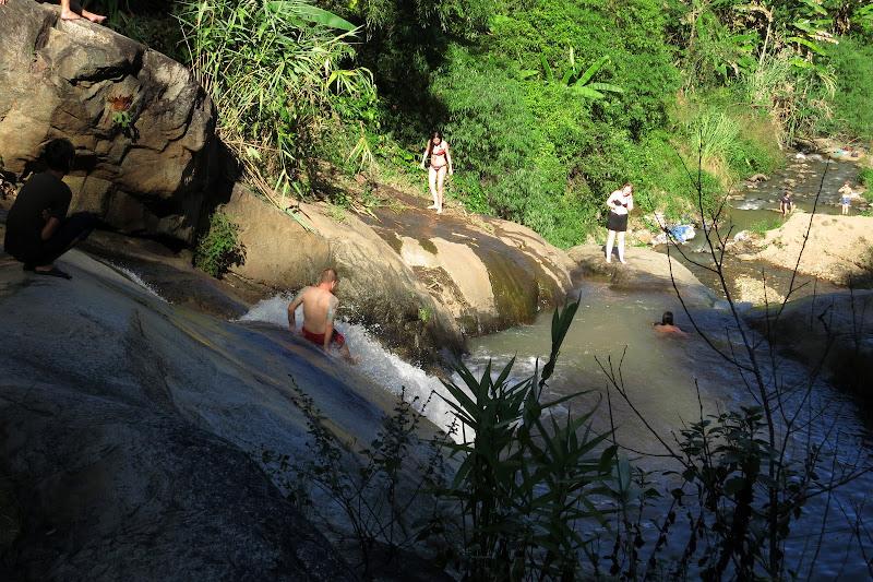 Tony sliding down Mor Paeng waterfall