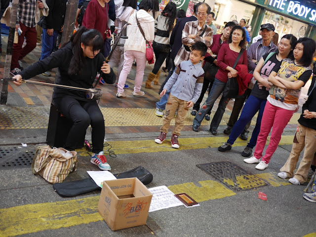 young woman playing an erhu at Sai Yeung Choi Street South