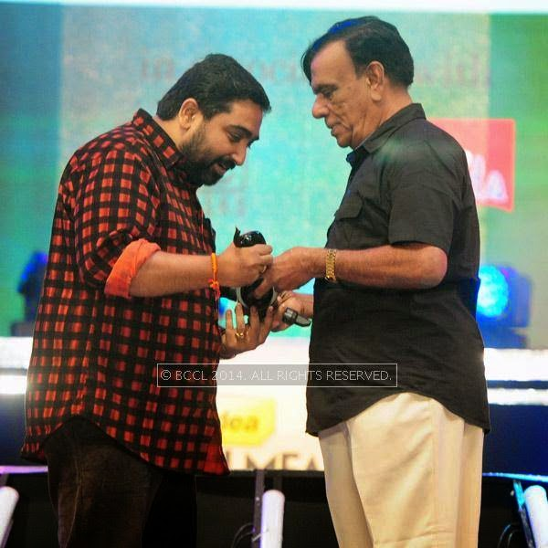 M Jayachandran receives Best Music Director Award for the movie Celluloid during the 61st Idea Filmfare Awards South, held at Jawaharlal Nehru Stadium in Chennai, on July 12, 2014.