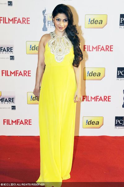 Tanisha Mukherjee opts for bright yellow gown which shows off her perfect curves at the 58th Idea Filmfare Awards 2013, held at Yash Raj Films Studios in Mumbai.Click here for:<br />  58th Idea Filmfare Awards