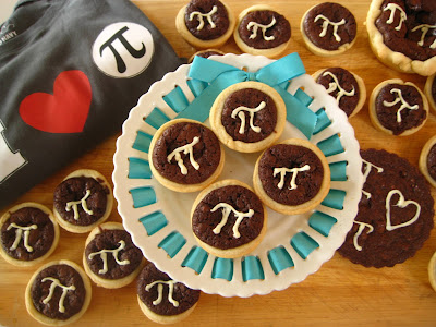 brownie pies decorated with pi symbol on white platter