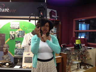 H. Blair Newby, Executive Director of Chatham-Kent Black Mecca Museum, Holding a bell on a slave yoke.