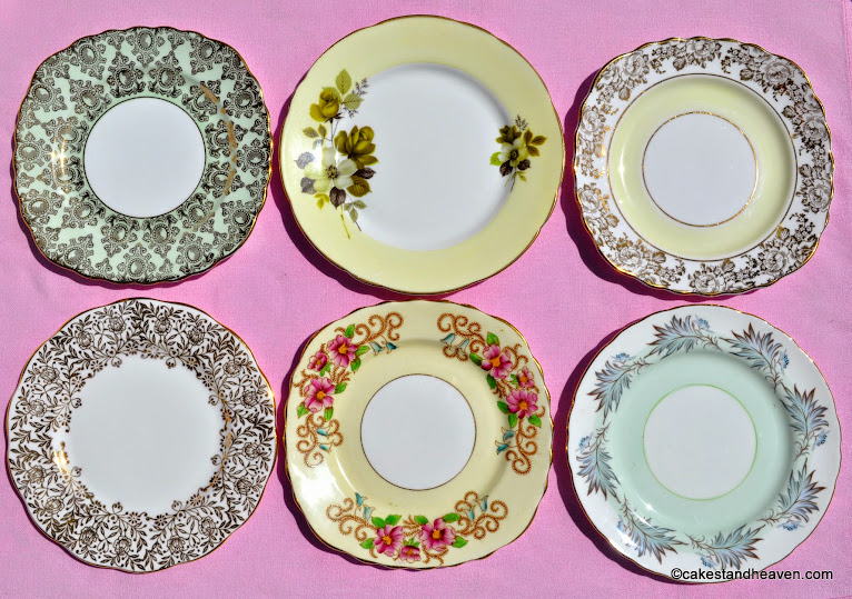 Six pastel green, yellow and gold tea plates