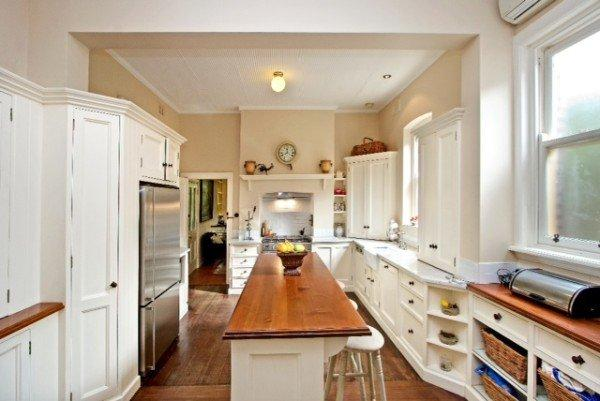 Kitchen with some original cabinetry and plaster ceiling with Australian motifs