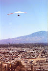 "Unknown HG pilot launches from ""A"" Mountain, overlooking downtown Tucson"