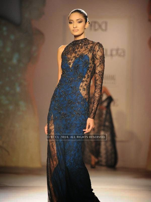 Archana walks the ramp for designer Gaurab Gupta on Day 3 of India Couture Week, 2014, held at Taj Palace hotel, New Delhi.<br />