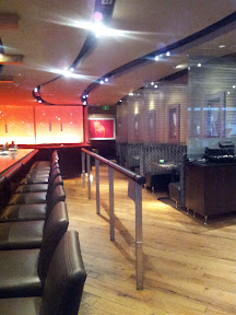 View of the bar and a few booths at Boka