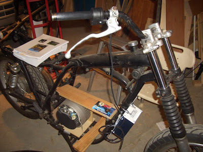 I put MAGURA throttle onto handle bar and motor controller onto frame front,which looks like oil cooler.