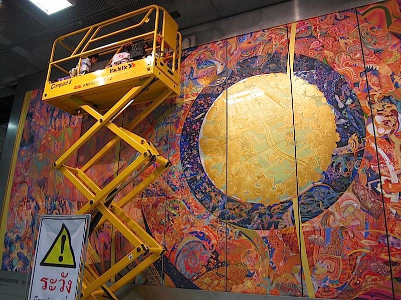 painters working on a mural at Bangkok's Suvarnabhumi Apirport