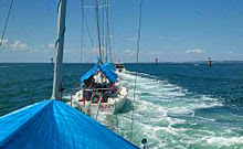 J24 sailboats under tow in Australia