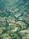 Another Madagascar village from the air, along a valley floor.