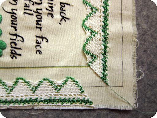 I found this lovely, old, crocheted trim with a touch of green at Brimfield. Immediately upon spotting it, I knew it would be perfect for an Irish Blessing. I baste stitched the trim around the blessing and mitered the corners so it looked complete.