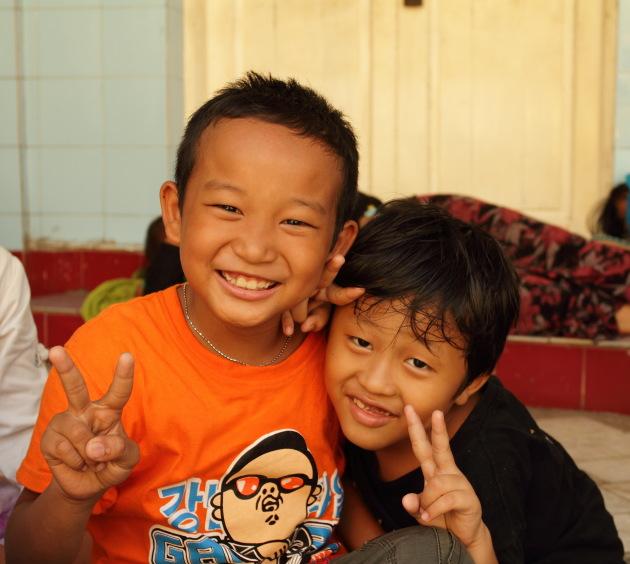 Young Burmese Boys pose for the camera at Sule Pagoda, Yangon, Burma