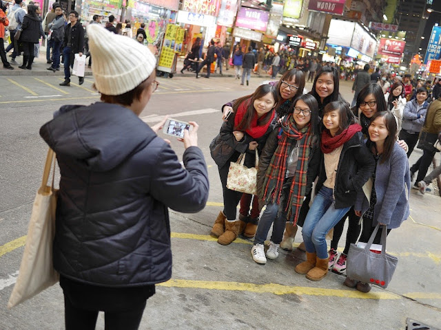 group of female college students having their photo taken at Sai Yeung Choi Street South