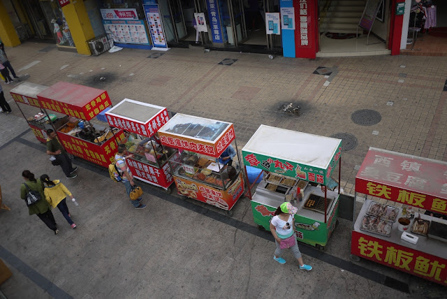 row of street food stalls