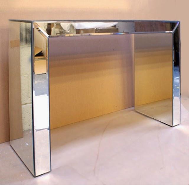 Ecleectica interiorismo muebles revestidos en espejo for Muebles de espejo