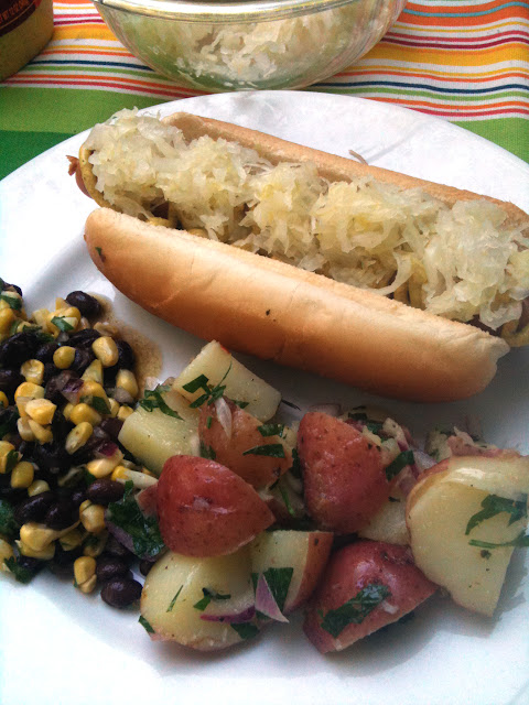 how's this for a outdoor feast: black bean and corn salad, local hot dogs with mustard and sour kraut, and Italian potato salad