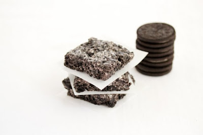 photo of a stack of Cookies and Cream Bars with a stack of Oreos in the background