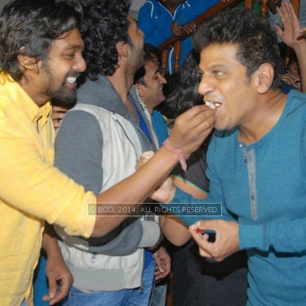 Dhruva Sarja and Shivarajkumar during the latter's birthday celebrations, in Bangalore.