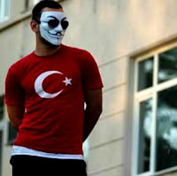 The mask popularised by the film V for Vendetta appeared in Gezi Park protests
