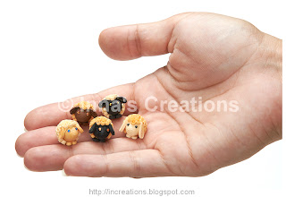 Quilled Agricola sheep on the palm of a hand