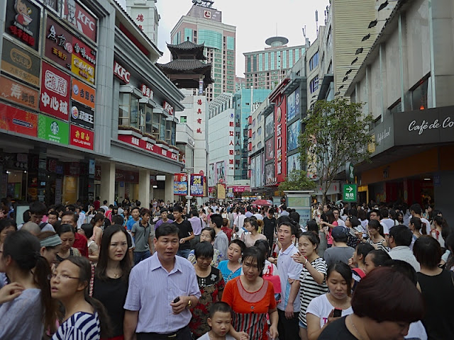 crowds at the Dongmen shopping area in Shenzhen, China