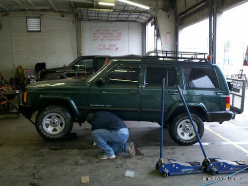 Lifting he Jeep to remove the transfer case.