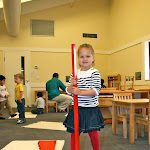 Preschool girl in private Irvine Montessori school working with the red rods sensorial material.