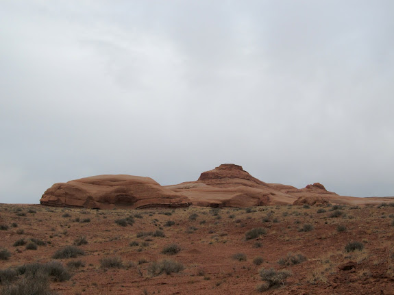 Sandstone buttes rising from the flat desert
