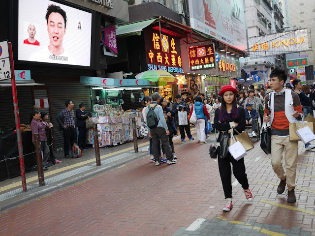 couple walking at a street near Sai Yeung Choi Street South