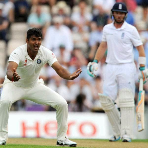 India's Pankaj Singh (L) unsuccesfully appeals for the wicket of England's Ian Bell (R) during the first day of the third cricket Test match between England and India at The Ageas Bowl cricket ground in Southampton on July 27, 2014.