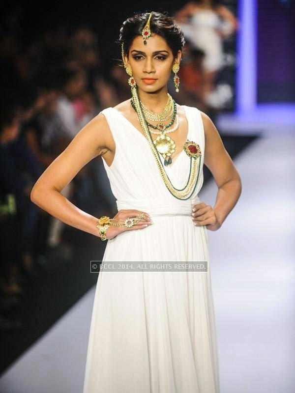 A model walks the ramp for IIGJ Mumbai on Day 1 of India International Jewellery Week (IIJW), 2014 at Grand Hyatt, Mumbai.