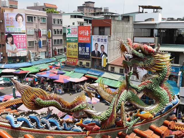 dragon in front of a market scene