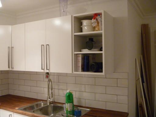 Second hand IKEA faktum cabinet into wine rack | Mauricio Munera.